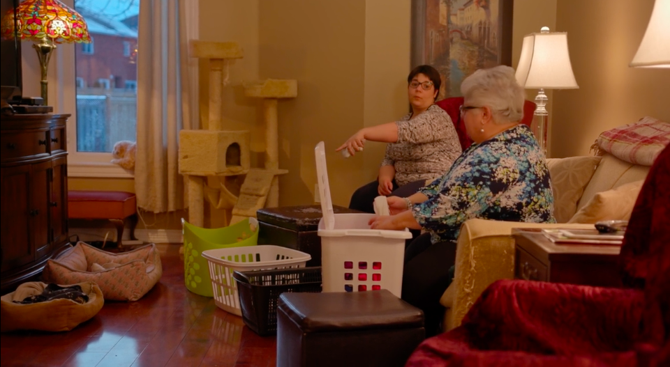 Amanda and her mom sort laundry while discussing the new responsibilities Amanda will take on when she moves into her own home.